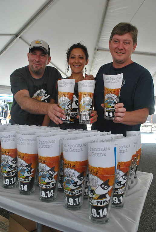 Description of . Joe Hess, Sarah Valentine and Karel Minor from the Humane Society Pennsylvania are ready for Phoenixville's first ever Pints for Pups.