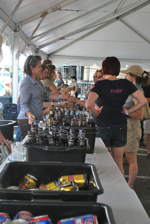 Description of . Event goers line up to taste the beers at Pints for Pups in Phoenixville Aug. 9.